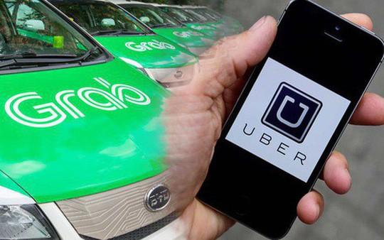 Vụ Grab mua lại Uber có dấu hiệu vi phạm Luật Cạnh tranh - Ảnh 1.