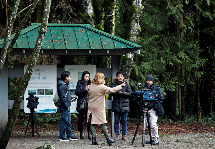 Members of the news media wait at the base of Horth Hill close to the property where according to British news reports Prince Harry and Meghan, Duchess of Sussex are staying in North Saanich, British Columbia, Canada January 21, 2020. REUTERS/Kevin Light