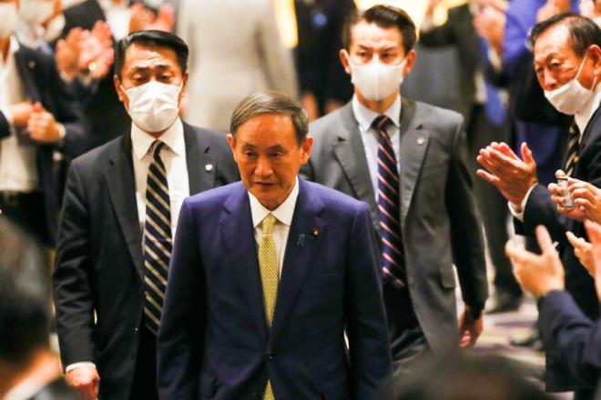 Tân Thủ tướng Nhật Bản Suga lo khó xây dựng quan hệ với các lãnh đạo thế giới - 1