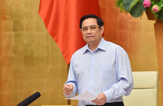 Thủ tướng Phạm Minh Chính chủ trì họp Thường trực Chính phủ với các địa phương về phòng chống Covid-19, tối 23/7. Ảnh: Nhật Bắc
