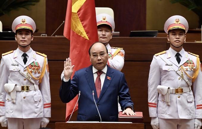 Chủ tịch nước Nguyễn Xuân Phúc tuyên thệ sáng 26/7. Ảnh: Giang Huy