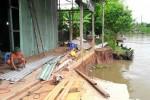 Nhà máy xay xát bất ngờ bị sông 'nuốt chửng' vào tinh mơ