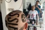 Gã CĐV gàn Sài thành Lê Anh Tiến... cạo đầu đi ủng hộ World Cup