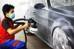 Dịch vụ sơn lại màu xe ôtô ngày cận Tết đắt khách, giá nhảy vọt